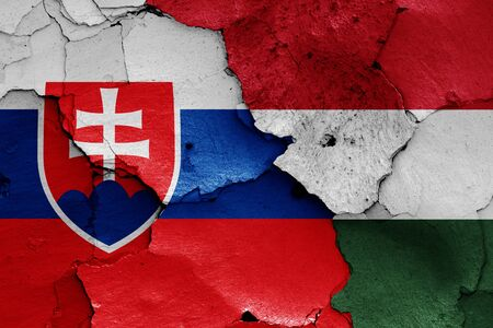 flags of Slovakia and Hungary painted on cracked wall