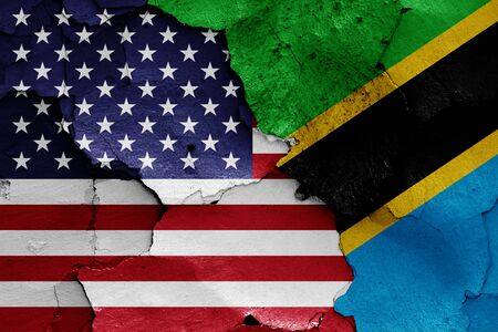 flags of USA and Tanzania painted on cracked wall