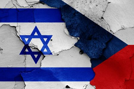 flags of Israel and Czech Republic painted on cracked wall