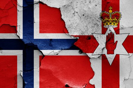 flags of Norway and Northern Ireland painted on cracked wall