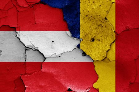 flags of Austria and Romania painted on cracked wall 免版税图像