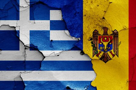 flags of Greece and Moldova painted on cracked wall