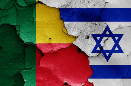 flags of Benin and Israel painted on cracked wall