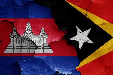 flags of Cambodia and East Timor painted on cracked wall Stok Fotoğraf