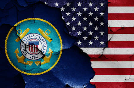 flags of United States Coast Guard and USA painted on cracked wall Banque d'images