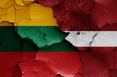Flags of Lithuania and Latvia painted on cracked wall Stock Photo