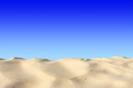 Sand dune on blue background Reklamní fotografie