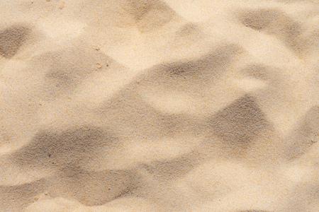 Fijn strandzand in de zomerzon Stockfoto