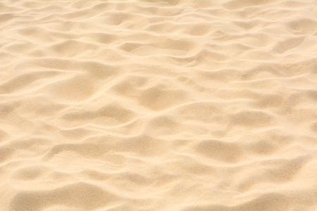 Full frame shot of sand texture on beach in the summer sun. Standard-Bild
