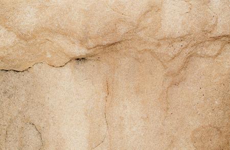 Disparo de fotograma completo de textura de piedra marrón. Foto de archivo