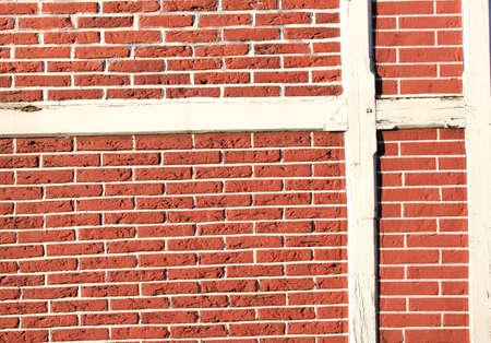 Timber framed wall red bricks photo