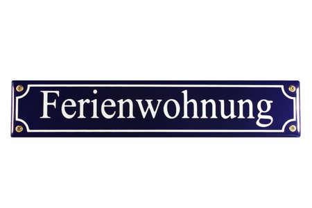 Ferienwohnung German Enamel Street Sign Stock Photo