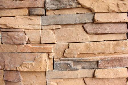 Brick wall light brown orange stones