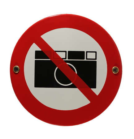 Round enamel sign no cameras allowed photo
