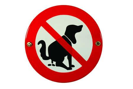 Round enamel sign no dog toilet Stock Photo