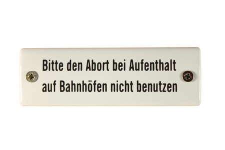 German railway sign Abort Aufenthalt Bahnhöfen benutzen