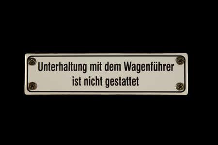 shingle: German railway sign Unterhaltung mit dem Wagenf�hrer nicht gestattet Stock Photo