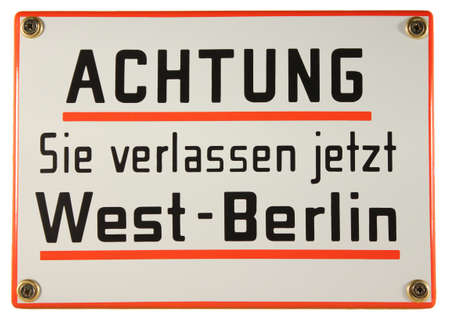 Schild Achtung verlassen West Berlin German enamel sign Stock Photo
