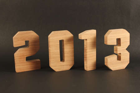 buchstabe: 2013 text from wood numbers Holz black Background Stock Photo