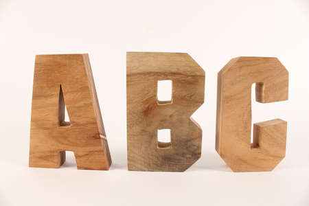 naturholz: ABC text from wood letters Holz Buchstaben white Background straight