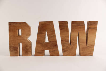 RAW text from wood letters Holz Buchstaben white Background straight