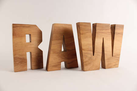 naturholz: RAW text from wood letters Holz Buchstaben white Background
