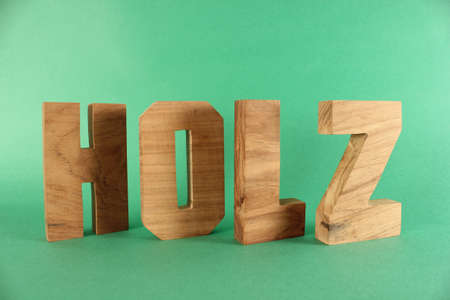 naturholz: HOLZ German text from wood letters Buchstaben black Background