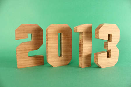 buchstabe: 2013 text from wood numbers Holz green Background Stock Photo