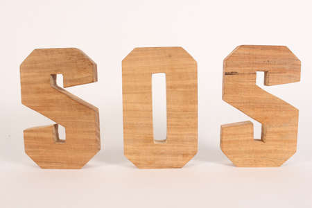 SOS text from wood letters Holz Buchstaben white Background straight