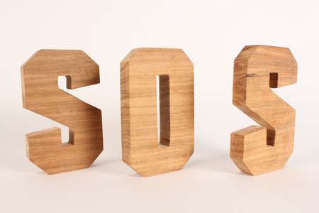 SOS text from wood letters Holz Buchstaben white Background