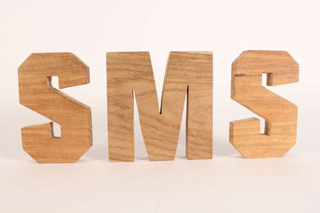 naturholz: SMS text from wood letters Holz Buchstaben white Background straight