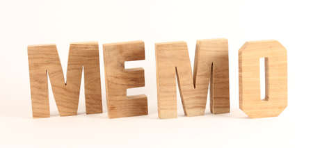 buchstaben: MEMO text from wood letters Buchstaben white Background Stock Photo