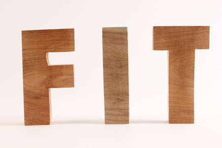 naturholz: FIT text from wood letters Buchstaben straight Stock Photo