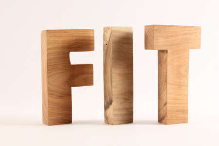 FIT text from wood letters Buchstaben white Background Stock Photo