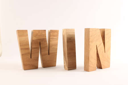 naturholz: WIN text from wood letters Buchstaben white Background Stock Photo