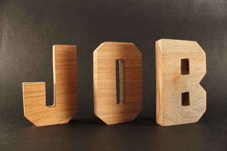 lettre: JOB text from wood letters Buchstaben black Background