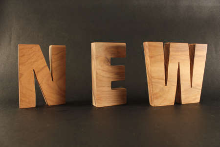naturholz: NEW text from wood letters Buchstaben black Background