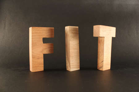 lettre: FIT text from wood letters Buchstaben black Background Stock Photo