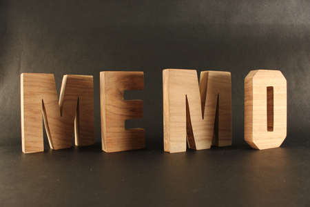 naturholz: HMEMO text from wood letters Buchstaben black Background