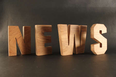 naturholz: NEWS text from wood letters Buchstaben black Background