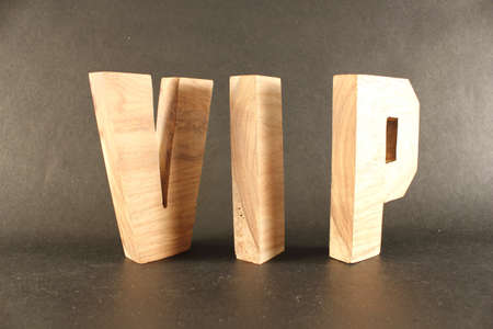 naturholz: VIP text from wood letters Buchstaben black Background Stock Photo