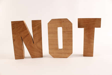 naturholz: NOT text from wood letters Holz Buchstaben white Background straight Stock Photo