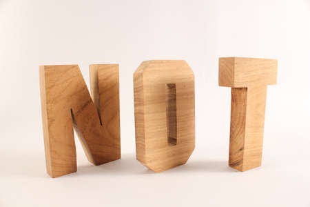 lettre: NOT text from wood letters Holz Buchstaben white Background