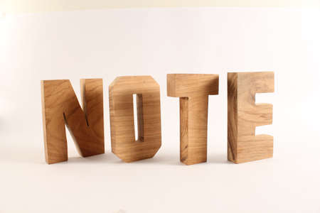 buchstaben: NOTE text from wood letters Holz Buchstaben white Background