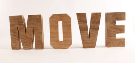 buchstaben: MOVE text from wood letters Holz Buchstaben white Background straight