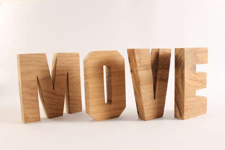 lettre: MOVE text from wood letters Holz Buchstaben white Background