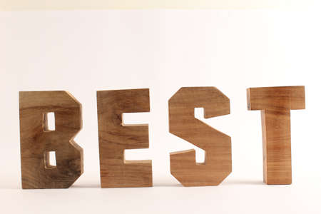 naturholz: BEST text from wood letters Holz Buchstaben white Background straight Stock Photo