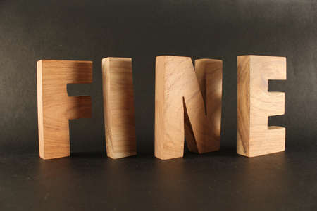 FINE text from wood letters Holz Buchstaben black Background Stock Photo