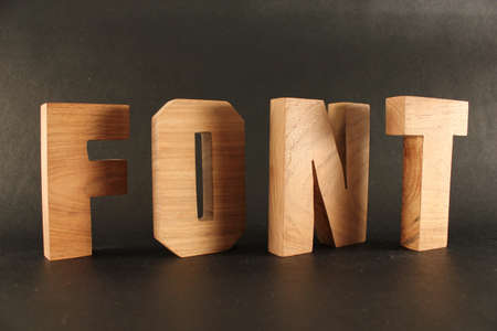 FONT text from wood letters Holz Buchstaben black Background Stock Photo
