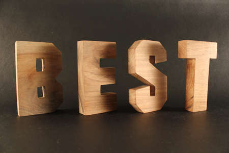 BEST text from wood letters Holz Buchstaben black Background